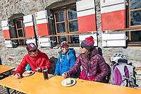 Taking a break to eat apple strudel at the Martin Busch Hut during the Öztal ski tour, Austria