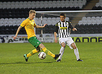 Josh Beattie plays the ball past Jamie Lindsay in the St Mirren v Celtic Scottish Professional Football League Under 20 match played at St Mirren Park, Paisley on 30.4.14.