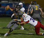 Galena quarterback Derek Kline gets away from the attempted tackle by Reno's #32 Reese Taylor in their football game played on Friday night Sept. 16, 2016 at Galena High School.