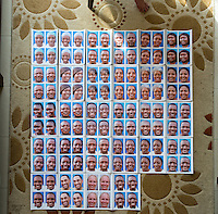 Occidental College professor Mary Beth Heffernan's first batch of portraits of a group of ELWA II ETU (Ebola treatment unit) health care workers taken in Monrovia, Liberia on Thurs., Feb. 24, 2015. The photos are made on adhesive backed paper and will be affixed to the worker's PPE (personal protective equipment) when they care for Ebola patients. Multiple prints of each person will ultimately be given to as many health care workers as possible at the faciltiy; <br /> (Photo by Marc Campos, Occidental College Photographer) Mary Beth Heffernan, professor of art and art history at Occidental College, works in Monrovia the capital of Liberia, Africa in 2015. Professor Heffernan was there to work on her PPE (personal protective equipment) Portrait Project, which helps health care workers and patients fighting the Ebola virus disease in West Africa.<br />