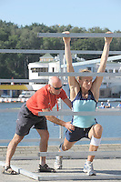 Poznan, POLAND,    BEL W1X Annick DE DECKER, gets helping hands from her coach/Physio as she prepares for a training session at the 2009 FISA World Rowing Championships. held on the Malta Rowing lake, Friday  21/08/2009 [Mandatory Credit. Peter Spurrier/Intersport Images]