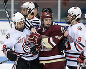 Mike Hewkin (NU - 28), Cam Atkinson (BC - 13), Wade MacLeod (NU - 19) - The Northeastern University Huskies defeated the Boston College Eagles 3-2 on Friday, February 19, 2010, at Matthews Arena in Boston, Massachusetts.