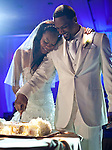 Richards and Ross cut the Jamaican rum cake, one of four cakes, during the recption. Olympic gold medalist, Sanya Richards, and New York Giants cornerback, Aaron Ross, wed at the Hyde Park Baptist in Austin, Texas on Friday, February 26, 2010...
