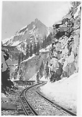 A northbound facing view of the Ophir Needles and RGS Bridge 46-E as seen from trackside on the high line.<br /> RGS    Taken by Griner, - 12/1944