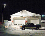 Fallen snow is piled in front and on top of the fire station at Rehoboth Beach, Delaware, USA, near the end of the Blizzard of February 2010.