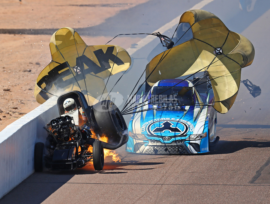 Feb 25, 2018; Chandler, AZ, USA; NHRA funny car driver John Force (left) crashes into the wall in front of Jonnie Lindberg during the Arizona Nationals at Wild Horse Pass Motorsports Park. Mandatory Credit: Mark J. Rebilas-USA TODAY Sports