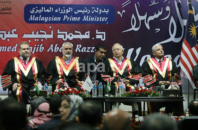 Malaysian Prime Minister Najib Razak  sits with Palestinian  prime minister Ismail Haniya during a visit to the Al-Aqsa University in Khan Yunis in the southern Gaza Strip January 22, 2013. Razak pledged solidarity with the Palestinians on his first trip to Gaza, and backed reconciliation efforts between Hamas and Fatah. Photo by Eyad Al Baba