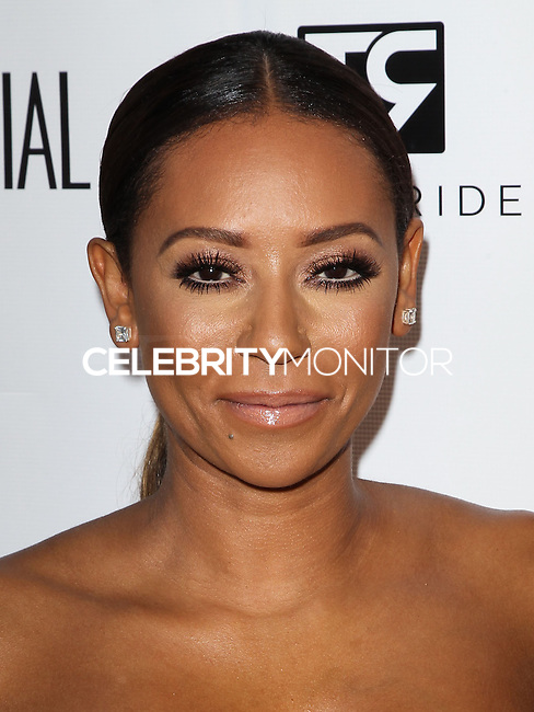 BEVERLY HILLS, CA, USA - JUNE 04: Mel B (Melanie Brown) arrives at the Los Angeles Confidential Magazine and cover star Robin Wright celebration of the magazine's Women Of Influence issue held at Sixty Hotel Beverly Hills on June 4, 2014 in Beverly Hills, California, United States. (Photo by Celebrity Monitor)