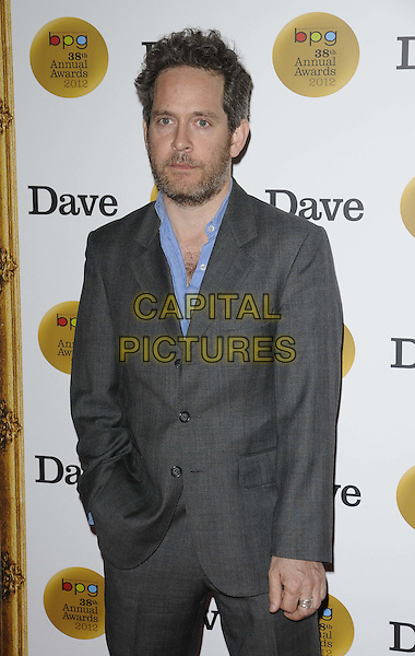Tom Hollander.The Broadcasting Press Guild ( BPG ) TV & Radio Awards 2012, Theatre Royal, Drury Lane, London, England..March 30th, 2012.half length black grey gray suit blue shirt beard facial hair .CAP/CAN.©Can Nguyen/Capital Pictures.