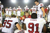 1 October 2006: Dave Tipton congratulates Pannell Egboh as Tom McAndrew looks on during Stanford's 31-0 loss to UCLA at the Rose Bowl in Pasadena, CA.