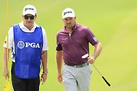 Graeme McDowell (NIR) and caddy Ken Comboy on the 13th green during Thursday's Round 1 of the 2017 PGA Championship held at Quail Hollow Golf Club, Charlotte, North Carolina, USA. 10th August 2017.<br /> Picture: Eoin Clarke | Golffile<br /> <br /> <br /> All photos usage must carry mandatory copyright credit (&copy; Golffile | Eoin Clarke)