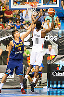 Spain's basketball player Willy Hernangomez and Angola's basketball player Bruno Fernando during the first match of the preparation for the Rio Olympic Game at Coliseum Burgos. July 12, 2016. (ALTERPHOTOS/BorjaB.Hojas)