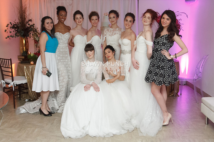 Designer Elizabeth LoPresti (for left) and International Sales Director Caraline Goodman (far right) pose with models pose in wedding dresses from the Pas de Deux Bridal collection, at the With This Ring event, host by Menagerie and Punto Space, at 325 West 38th street in New York City, during New York Bridal Fashion Week Spring Summer 2017.