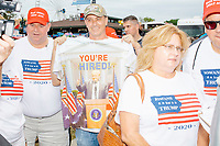 "People wearing ""Iowans for Trump"" shirts gathered near the Political Soapbox at the Iowa State Fair in Des, Moines, Iowa, on Sun., Aug. 11, 2019."