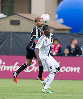 Justin Morrow of Earthquakes battles for the ball against Edson Buddle of Galaxy during the game at Buck Shaw Stadium in Santa Clara, California on October 21st, 2012.  San Jose Earthquakes and Los Angeles Galaxy tied at 2-2.