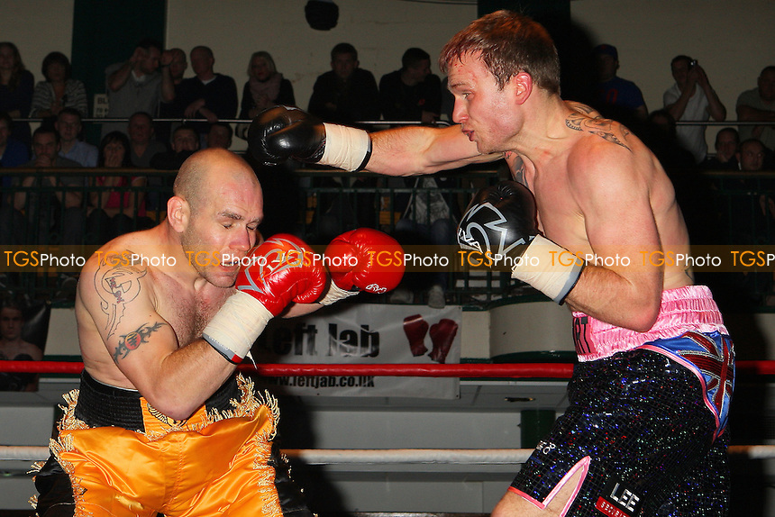 Scott Hartley (black/pink shorts) draws with Stuart Maddox in a Super-Middleweight boxing contest at York Hall, Bethnal Green, promoted by Miranda Carter / Left Jab Promotions - 13/11/11 - MANDATORY CREDIT: Gavin Ellis/TGSPHOTO - Self billing applies where appropriate - 0845 094 6026 - contact@tgsphoto.co.uk - NO UNPAID USE.