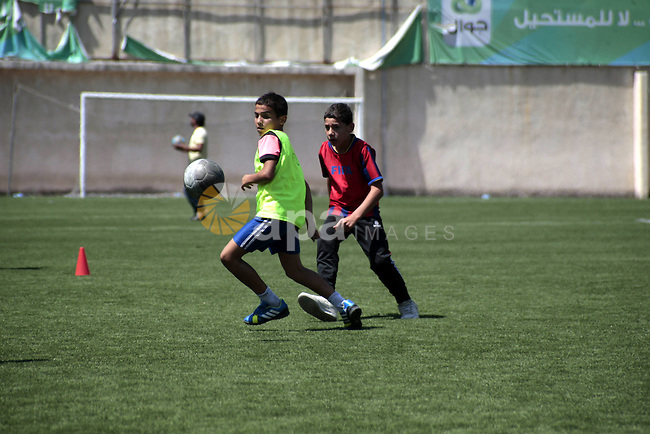 Palestinian boys play soccer during training exercises at a playground in the West Bank city of Nablus, June 27, 2013. About 200 Palestinian boy from the West Bank participated in the exercises to join the Palestinian Football Academy and with support from FIFA President Joseph S. Blatter. Photo by Nedal Eshtayah