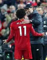 27th October 2019; Anfield, Liverpool, Merseyside, England; English Premier League Football, Liverpool versus Tottenham Hotspur; Mohammed Salah of Liverpool speaks with Liverpool manager Jurgen Klopp as he is substituted off  - Strictly Editorial Use Only. No use with unauthorized audio, video, data, fixture lists, club/league logos or 'live' services. Online in-match use limited to 120 images, no video emulation. No use in betting, games or single club/league/player publications