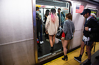 NEW YORK - NEW YORK. JANUARY 12: Participants of the No Pants Subway Ride take the train at the NYC subway system on January 12, 2020 in New York. The annual event, in which participants board a subway car in January while not wearing any pants while behaving as though they do not know each other, began as a joke by the public prank group Improv Everywhere in New York City and has since spread around the world, with enthusiasts in around 60 cities and 29 countries across the globe, according to the organization's site.  (Photo by Pablo Molsalve/VIEWpress)