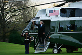United States President George W. Bush waves as he boards Marine One while departing the White House November 26, 2008 in Washington, DC. President Bush and his family are headed to Camp David for the Thanksgiving holiday.  <br /> Credit: Mark Wilson / Pool via CNP