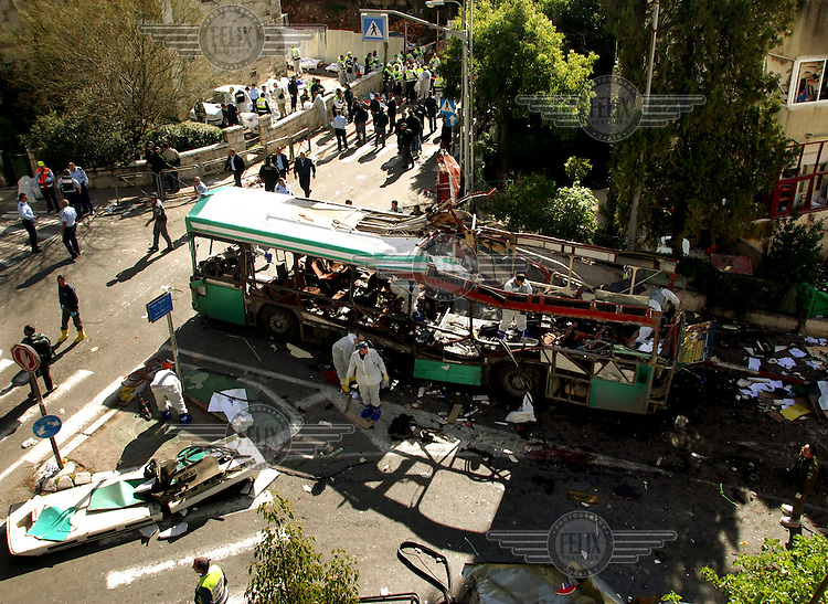 Scene of devastation following the suicide bombing of a bus which killed at least ten people and wounded dozens. The Al-Aqsa Martyrs Brigade claimed responsibility for the attack.