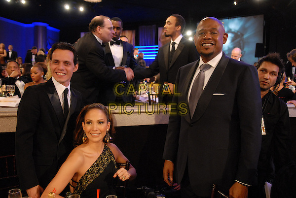 "MARC ANTHONY, JENNIFER LOPEZ & FOREST WHITAKER.Telecast - 64th Annual Golden Globe Awards, Beverly Hills HIlton, Beverly Hills, California, USA..January 15th 2007. .globes half length husband wife married black suit jacket one shoulder dress Marchesa sitting.CAP/AW.Please use accompanying story.Supplied by Capital Pictures.© HFPA"" and ""64th Golden Globe Awards"""