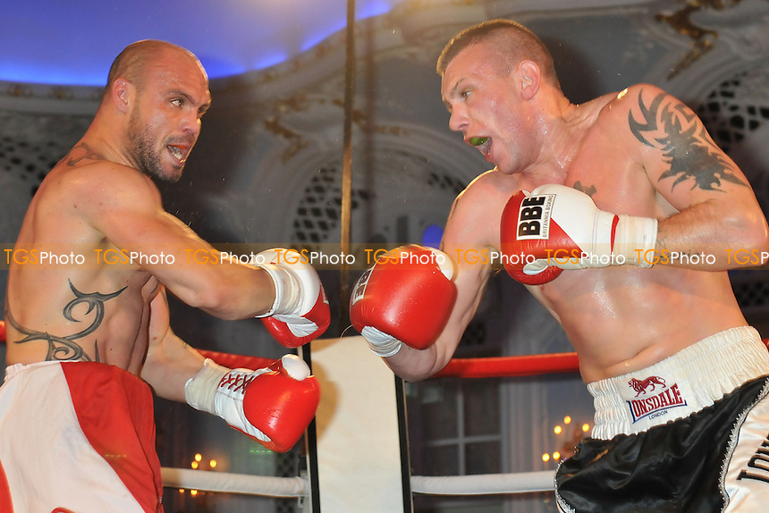 JJ McDonagh (black shorts) defeats Tzvetzar Lliev in a Super-Middleweight boxing contest at the Savoy Hotel, The Strand, London - 21/11/13 - MANDATORY CREDIT: Philip Sharkey/TGSPHOTO - Self billing applies where appropriate - 0845 094 6026 - contact@tgsphoto.co.uk - NO UNPAID USE