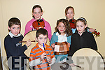 MUSICIANS: Playing a big part in the Concert in the GAA Hall, Ballylongford, on Friday night were, front: Michael, Conor and Grainne Heaphy (Listowel) and Aisling Finucane (Tarbert). Back: Elaine Hudson and Ciara Fitzgerald (Moyvane)..