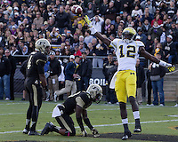Michigan wide receiver Devin Gardner (12) celebrates his 23-yard touchdown catch as Purdue safety Taylor Richards (4) and cornerback Josh Johnson (28) look on. The Michigan Wolverines defeated the Purdue Boilermakers 44-13 on October 6, 2012 at Ross-Ade Stadium in West Lafayette, Indiana.