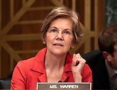 """United States Senator Elizabeth Warren (Democrat of Massachusetts) questions the witnesses during the US Senate Committee on Banking, Housing and Urban Affairs hearing titled """"Implementation of the Economic Growth, Regulatory Relief, and Consumer Protection Act"""" on Capitol Hill in Washington, DC on Tuesday, October 2, 2018.<br /> Credit: Ron Sachs / CNP"""