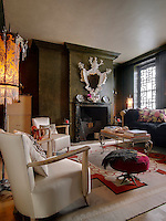This Georgian sitting room is decorated with eccentric lampshades, objects and contemporary furniture