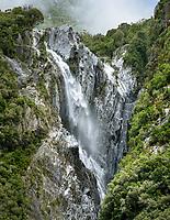 Waterfall in Franz Josef Glacier valley, Westland Tai Poutini National Park, UNESCO World Heritage Area, West Coast, South Westland, New Zealand, NZ