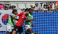 GRENOBLE, FRANCE - JUNE 12: Rita Chikwelu #10 of the Nigerian National Team, Boram Hwang #4 of the Korean National Team, Chidinma Okeke #20 of the Nigerian National Team battle for head ball during a game between Korea Republic and Nigeria at Stade des Alpes on June 12, 2019 in Grenoble, France.