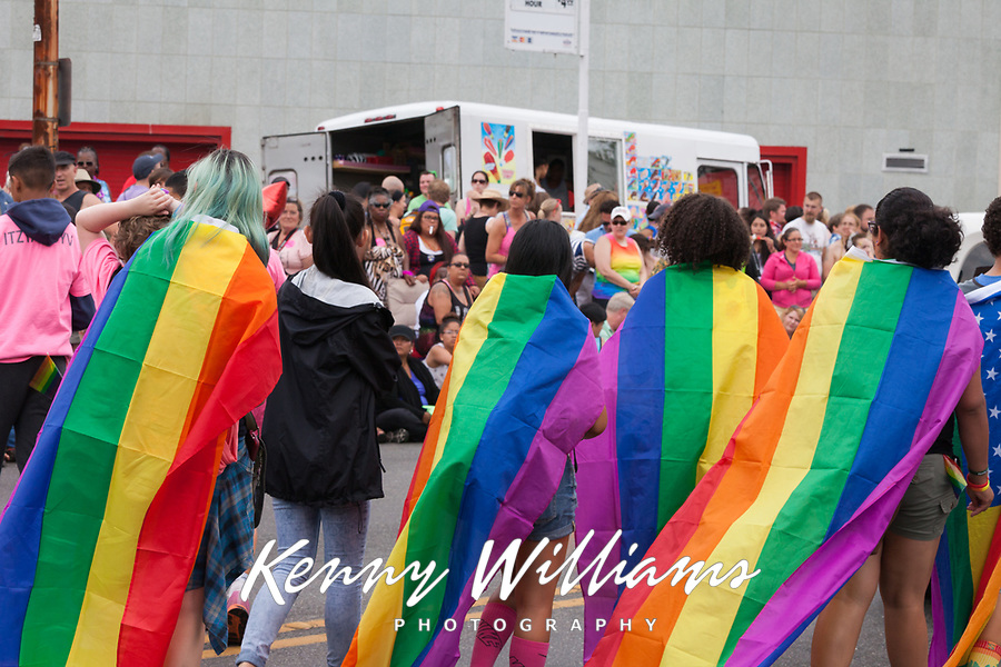Group of women wearing rainbow colored gay pride flags, Seattle PrideFest 2015, Washington State, WA, America, USA.