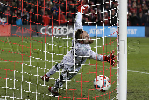 10.12.206. Toronto, ONT, Canada. MLS Football League Cup.Stefan Frei #24 of Seattle Sounders cannot stop Jozy Altidore #17 of Toronto FC (not pictured) first penalty kick of the MLS Cup Final on December 10, 2016, at BMO Field in Toronto, ON, Canada. Seattle won 5-4 on penalty kicks.