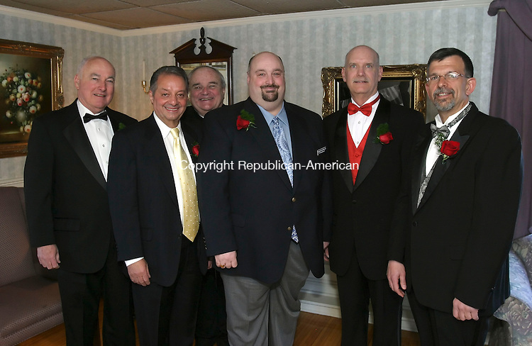 SOUTHINGTON, CT 4/9/07- 040907BZ04- From left- Honoree William Sullivan; Carmen Anthony Vacalebre, corporation of the year; Father James Coleman, humanitarian of the Year; Art Lanese Jr., Preisdent of the Sportsmen's Club; honoree William Hogg; honoree Fran Vitarelli; at the 33rd annual Sportsmen's Club dinner at the Aqua Turf in Southington Monday night.<br /> Jamison C. Bazinet Republican-American
