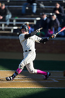 Kevin Conway (7) of the Wake Forest Demon Deacons follows through on his swing against the Virginia Tech Hokies at Wake Forest Baseball Park on March 7, 2015 in Winston-Salem, North Carolina.  The Hokies defeated the Demon Deacons 12-7 in game one of a double-header.   (Brian Westerholt/Four Seam Images)