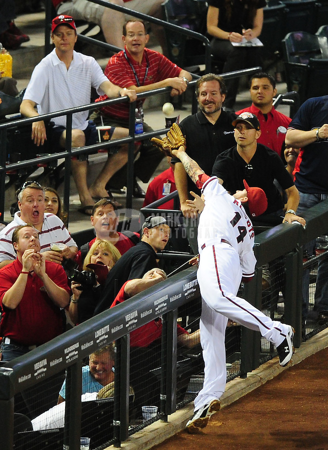 Apr. 26, 2011; Phoenix, AZ, USA; Arizona Diamondbacks third baseman Ryan Roberts makes a catch in foul territory in the third inning against the Philadelphia Phillies at Chase Field. Mandatory Credit: Mark J. Rebilas-