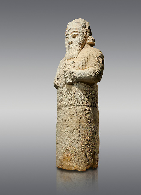 Hittite monumental statue probably of Tarhunda, the Storm God, standing on a cart being pulled by two bulls. Adana Archaeology Museum, Turkey. Against a grey background
