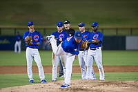 AZL Cubs infielders Luis Vazquez (18), Cam Balego (82), Marcus Mastrobuoni (5), and Delvin Zinn (21) look on as relief pitcher Nathan Sweeney (47) follows through on a warmup pitch during a game against the AZL Brewers on August 6, 2017 at Sloan Park in Mesa, Arizona. AZL Cubs defeated the AZL Brewers 8-7. (Zachary Lucy/Four Seam Images)