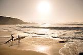 USA, Hawaii, Oahu, Surfers on beach prepare to enter the water, Waimea Bay