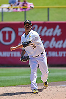 Atahualpa Severino (18) of the Salt Lake Bees warms up in the bullpen before entering the game against the Fresno Grizzlies in Pacific Coast League action at Smith's Ballpark on June 14, 2015 in Salt Lake City, Utah.  (Stephen Smith/Four Seam Images)