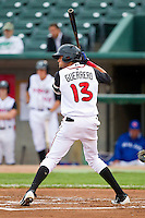Emilio Guerrero (13) of the Lansing Lugnuts at bat against the Fort Wayne TinCaps at Cooley Law School Stadium on June 5, 2013 in Lansing, Michigan.  The TinCaps defeated the Lugnuts 8-5.  (Brian Westerholt/Four Seam Images)