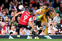 Sam Morsy of Wigan in action as Brentford's Neal Maupay looks on during Brentford vs Wigan Athletic, Sky Bet EFL Championship Football at Griffin Park on 15th September 2018