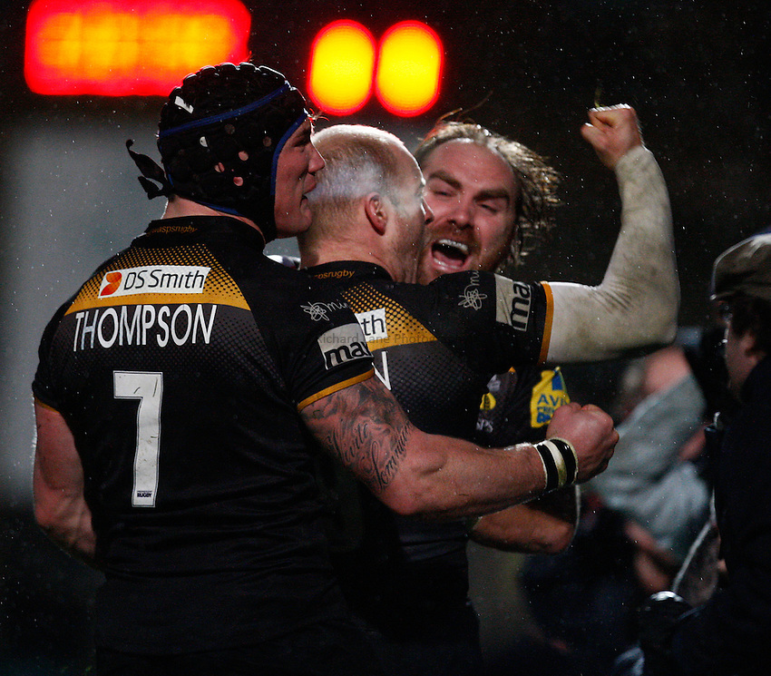 Photo: Richard Lane/Richard Lane Photography. London Wasps v Exeter Chiefs. Aviva Premiership. 05/01/2014. Wasps' Joe Simpson celebrates his try with Andy Goode and guy Thompson.