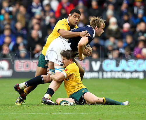 12.11.2016. BT Murrayfield Stadium, Edinburgh, Scotland. Autumn International Rugby. Scotland versus Australia.  Scotlands Jonny Gray is double-tackled