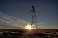 A windmill at sunset in the Cimarron National Grassland near Elkhart Kansas.