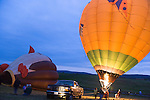 "Hot air balloonists  at the Shenandoah Valley Hot Air Balloon Festival at Historic Long Branch in Millwood, Virginia fire a propane burner to heat the air in the balloon ""envelope"" to keep the balloon upright.  Since hot air rises, this causes the balloon to stand up, and eventually fly."