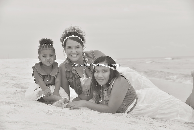 Mom and daughters at beach
