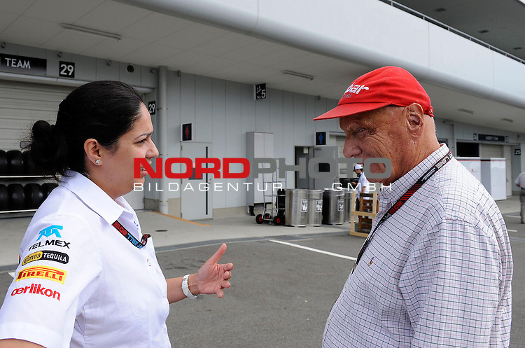 11. 13.10.2013, Suzuka International Racing Course, Suzuka, JPN, F1, Grosser Preis von Japan, Suzuka, im Bild  Monisha Kaltenborn (AUT), Sauber F1 Team, Managing Director - Niki Lauda (AUT) 3x F1 World Champion, Mercedes-Benz non-executive chairman of the board of directors <br /> for Austria &amp; Germany Media usage only!<br />  Foto &copy; nph / Mathis